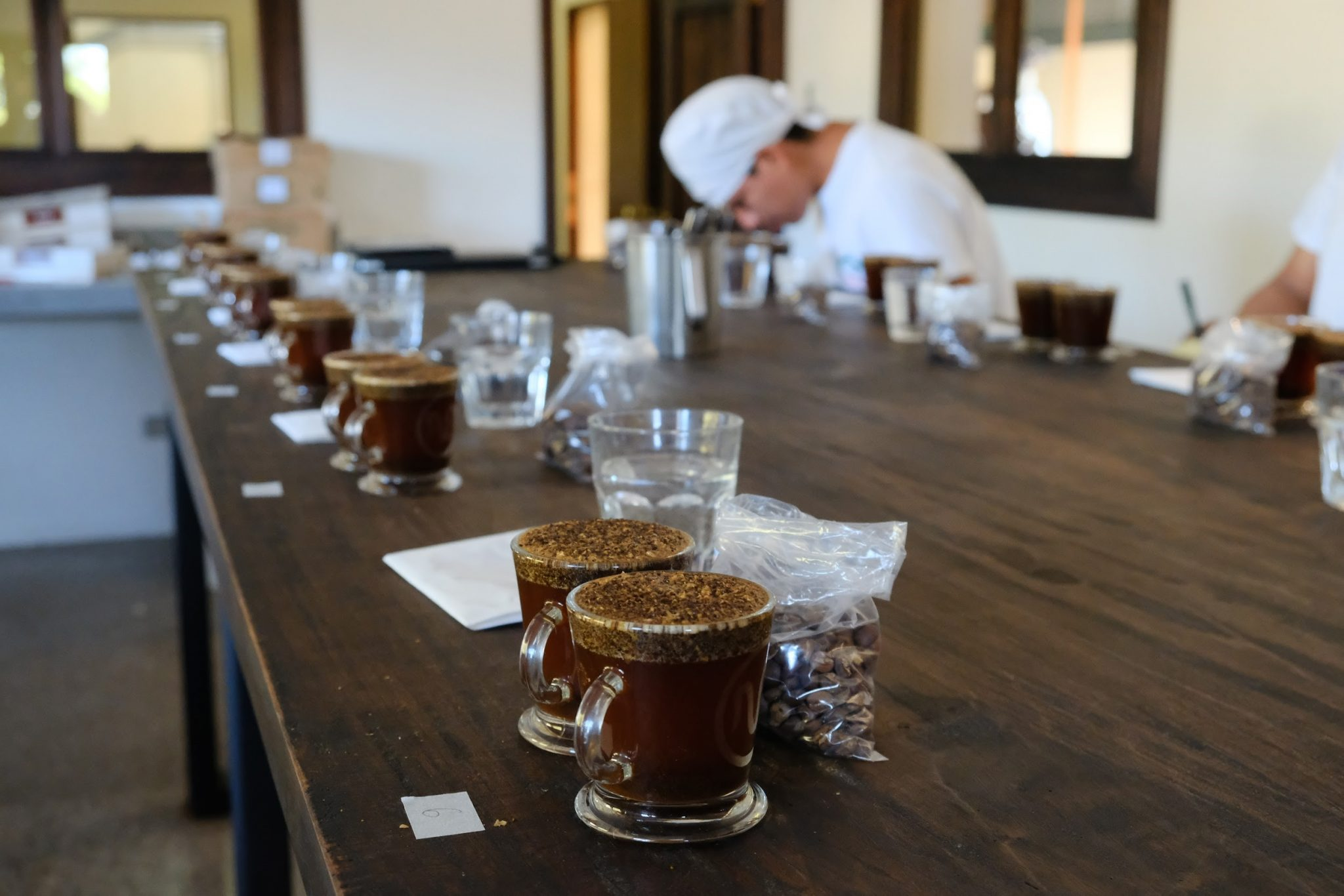 A man smells a coffee during a coffee cupping