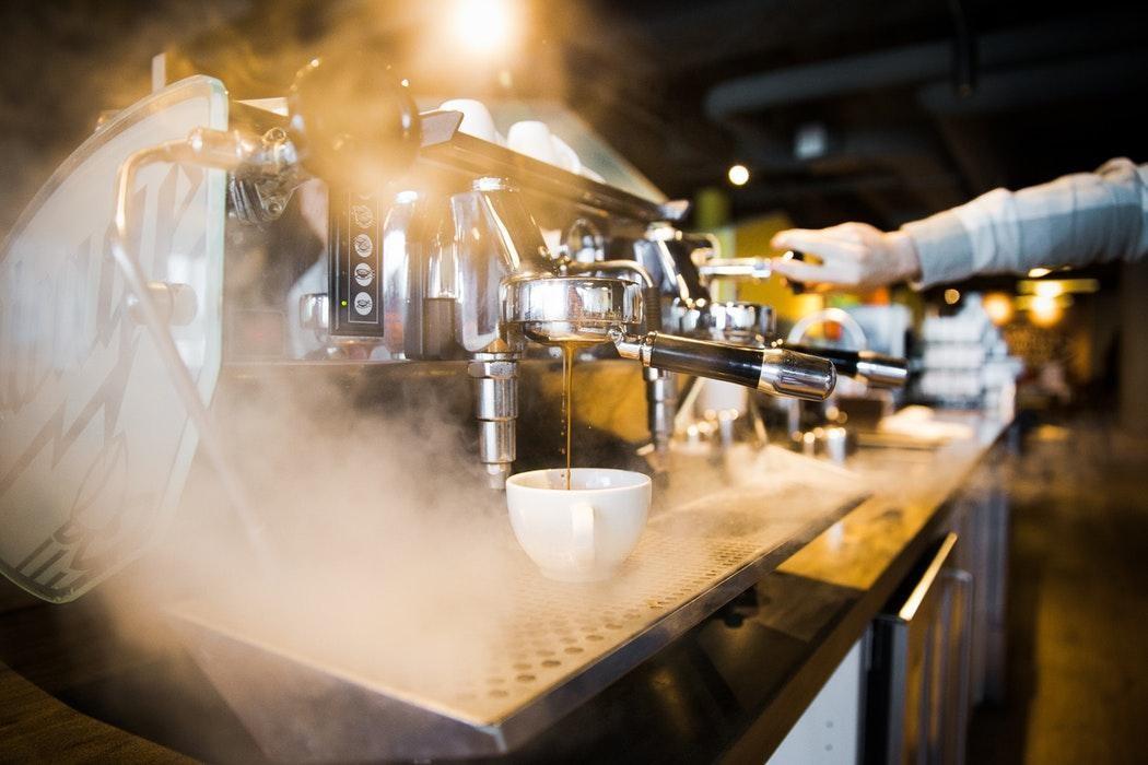 An espresso machine pulling some espressos