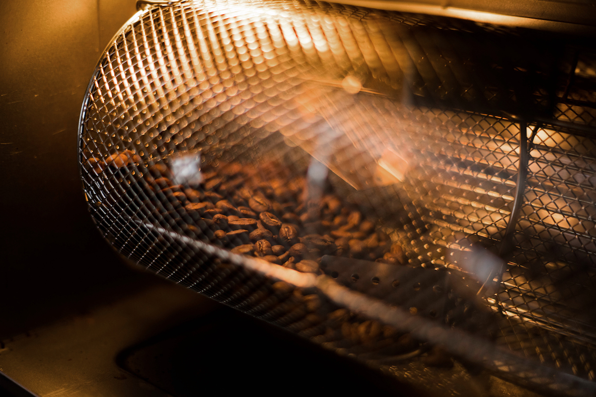 Roasted coffee beans coolinhh in a cooling tray