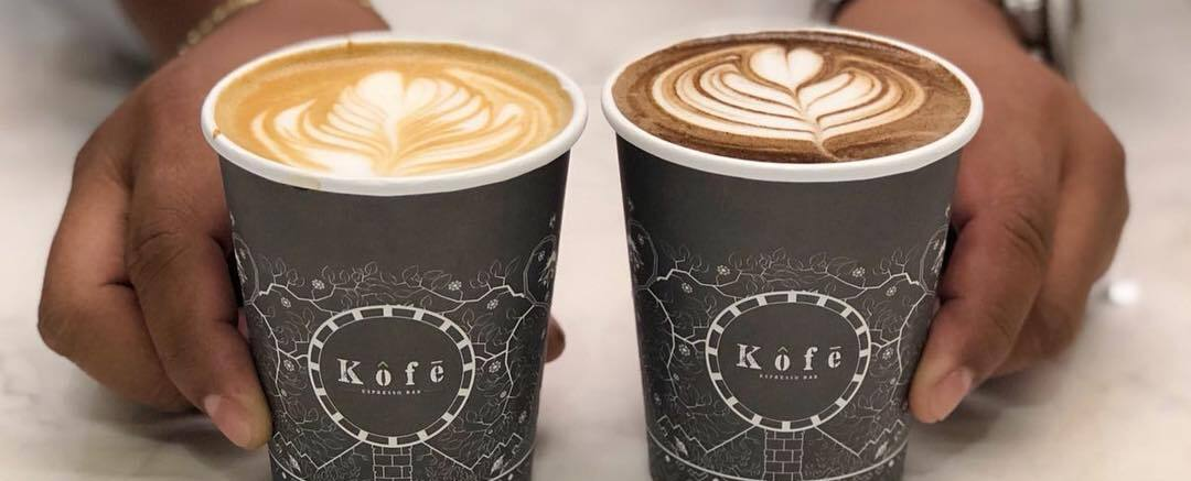 A latte and a moka in disposable cups
