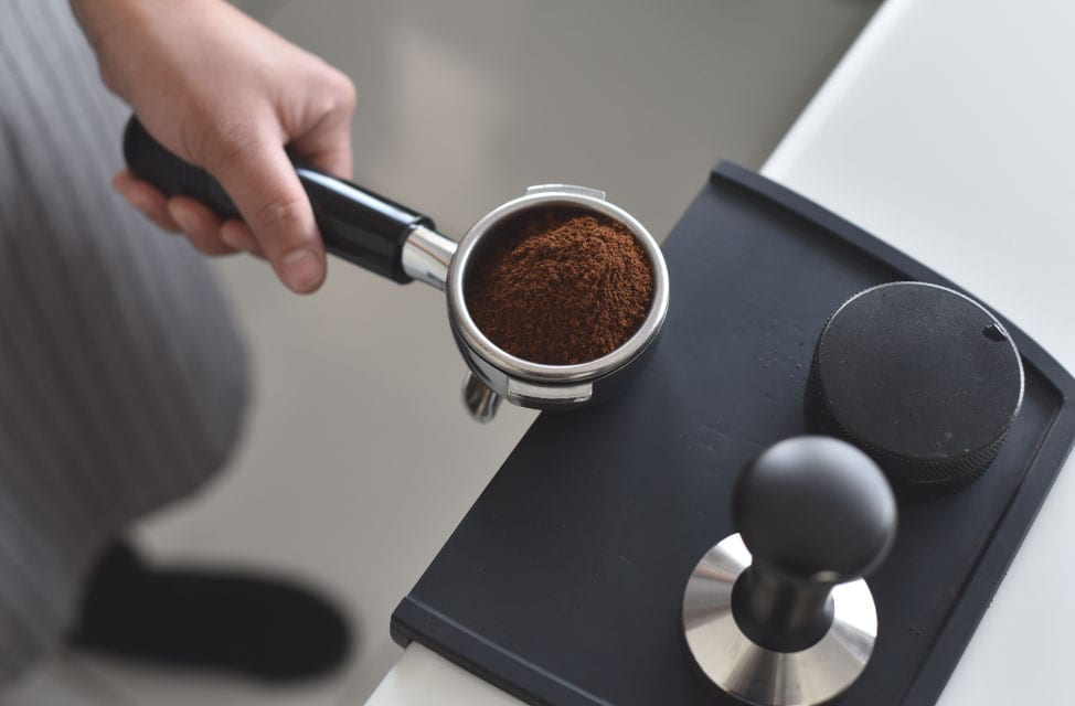 A-barista-gets-ready-to-tamp