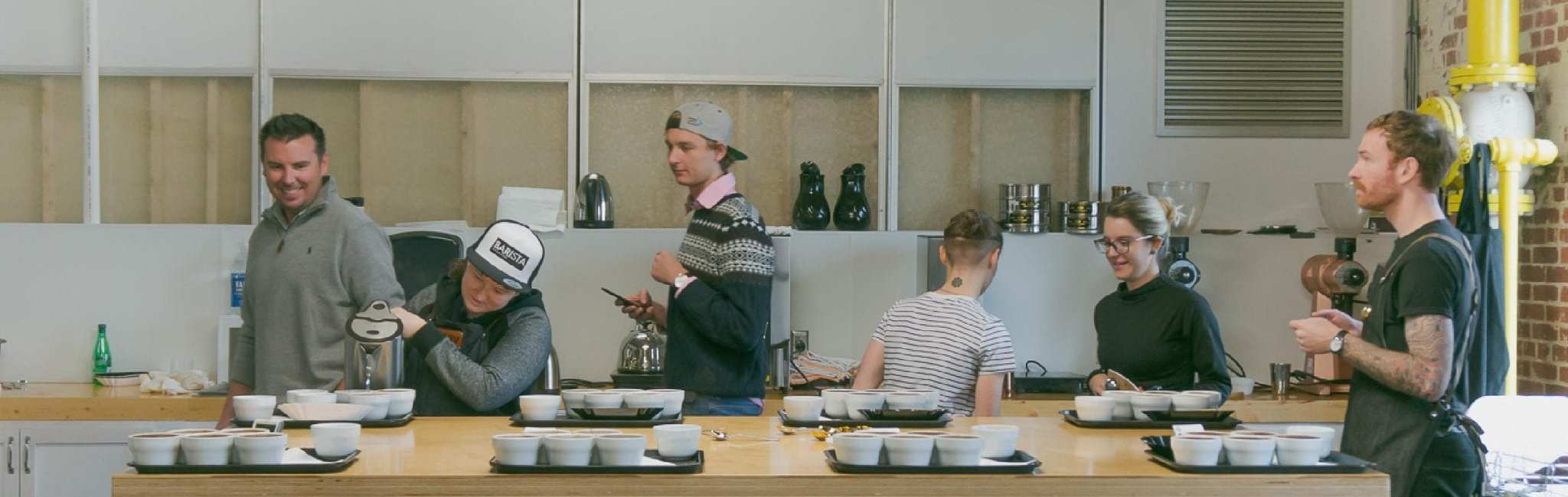 Baristas doing a cupping