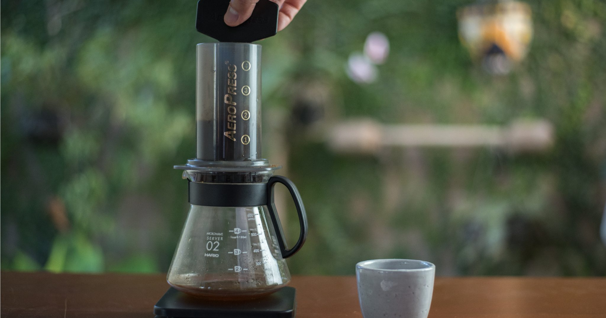 Barista brewing an aeropress on a v60 decanter