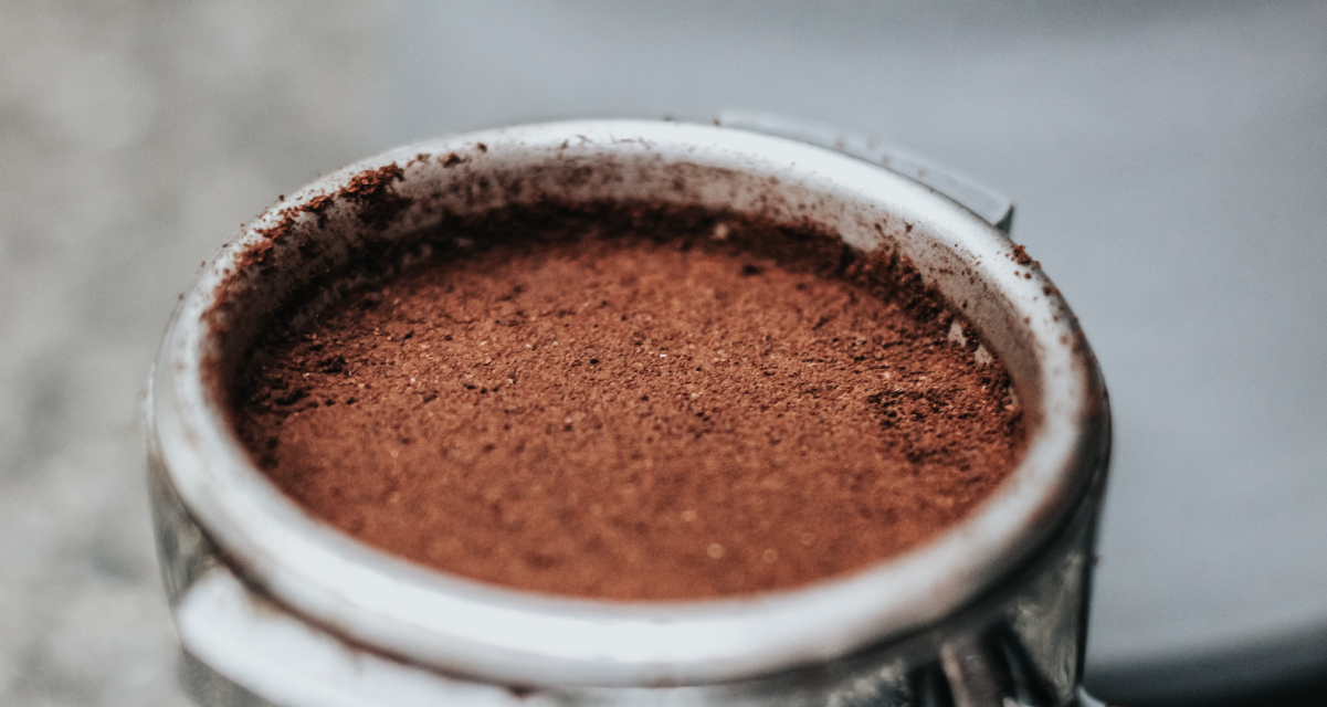 Tamped grinded coffee in a portafilter