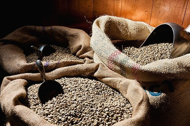 Unroasted coffee beans in bags