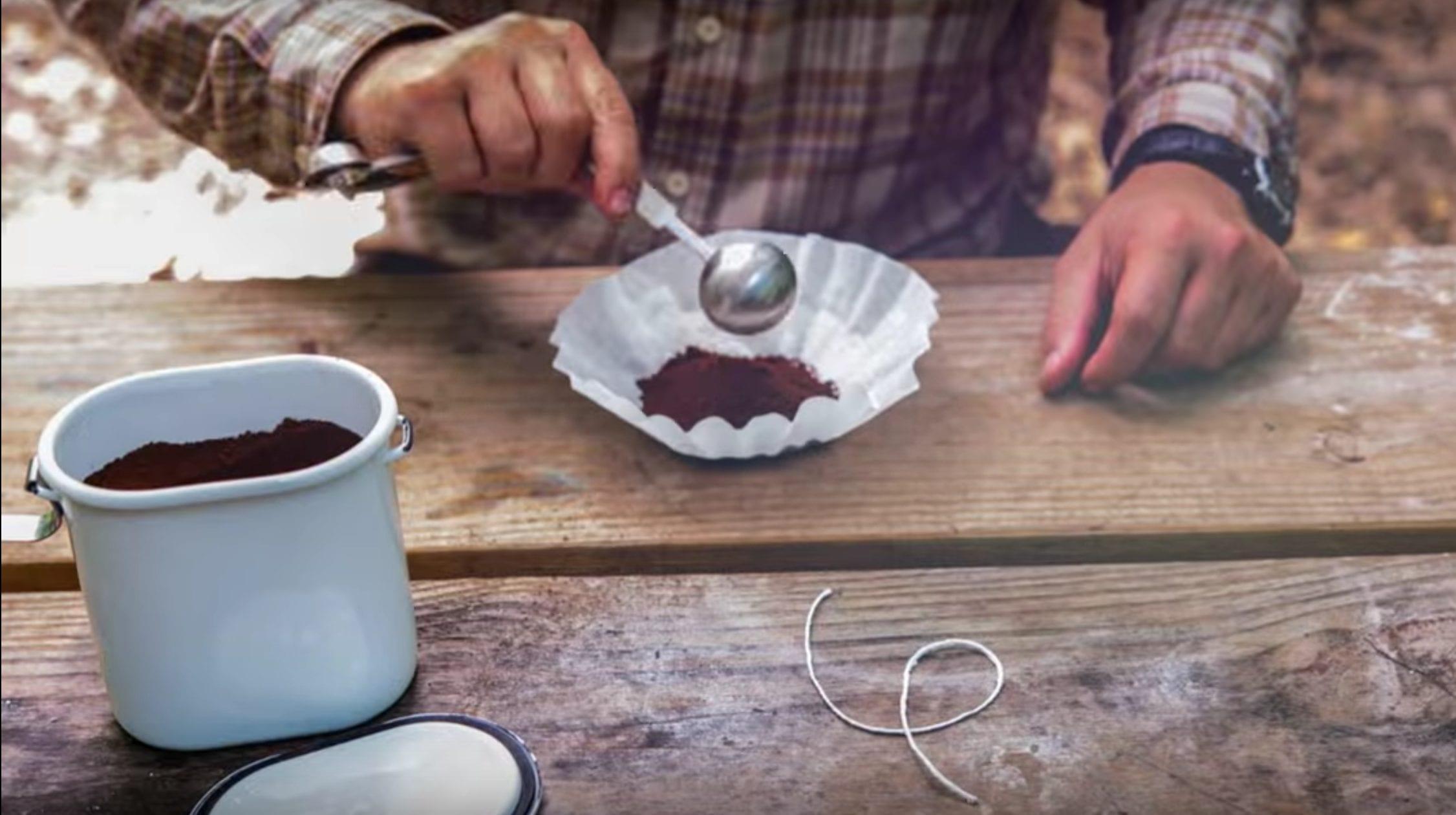 man putting coffee in filter