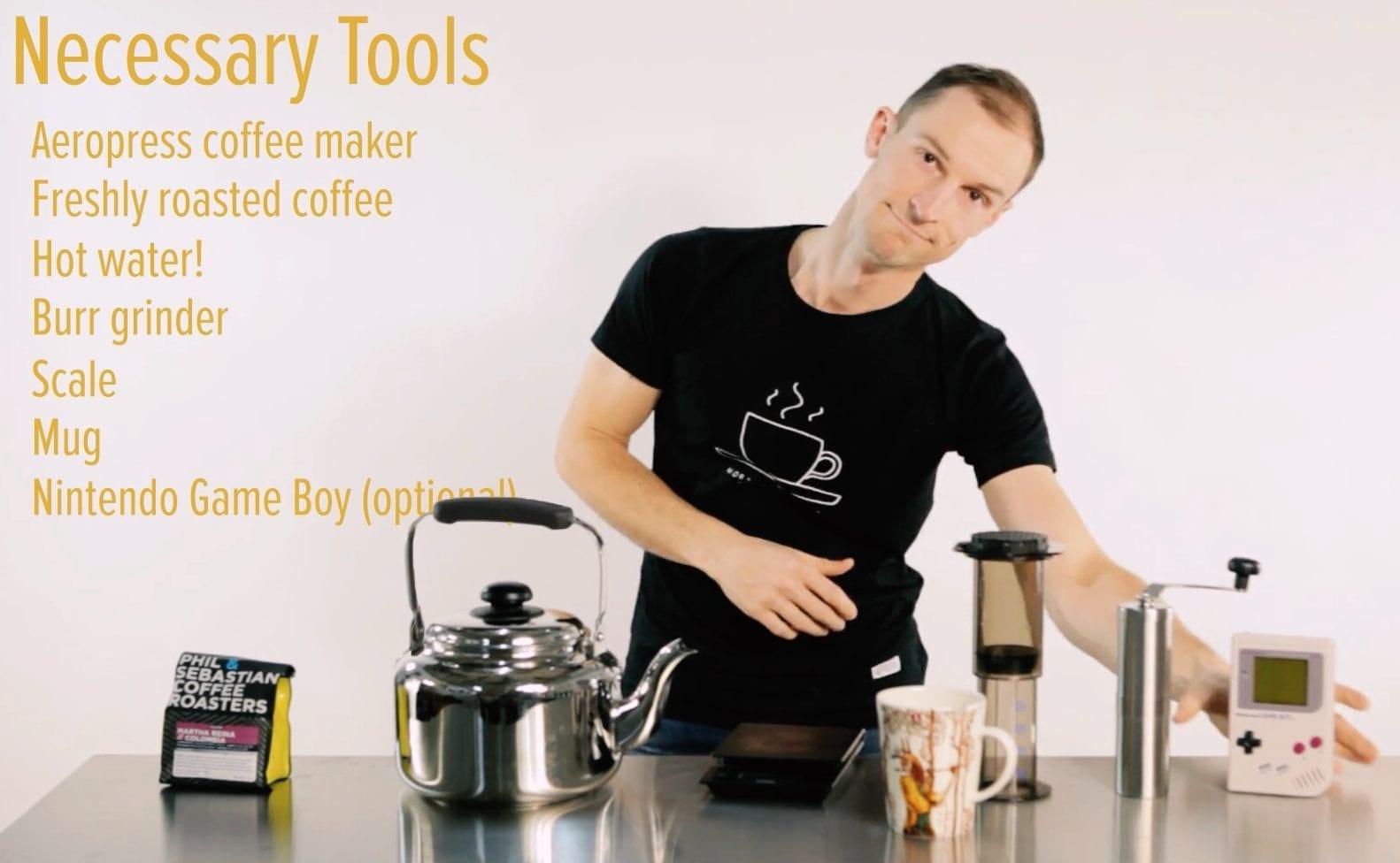 funny man brewing aeropress coffee with kit