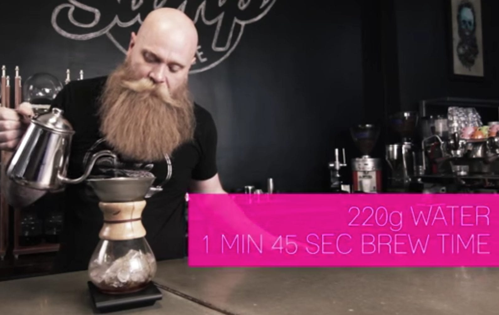 bearded hipster brewing coffee