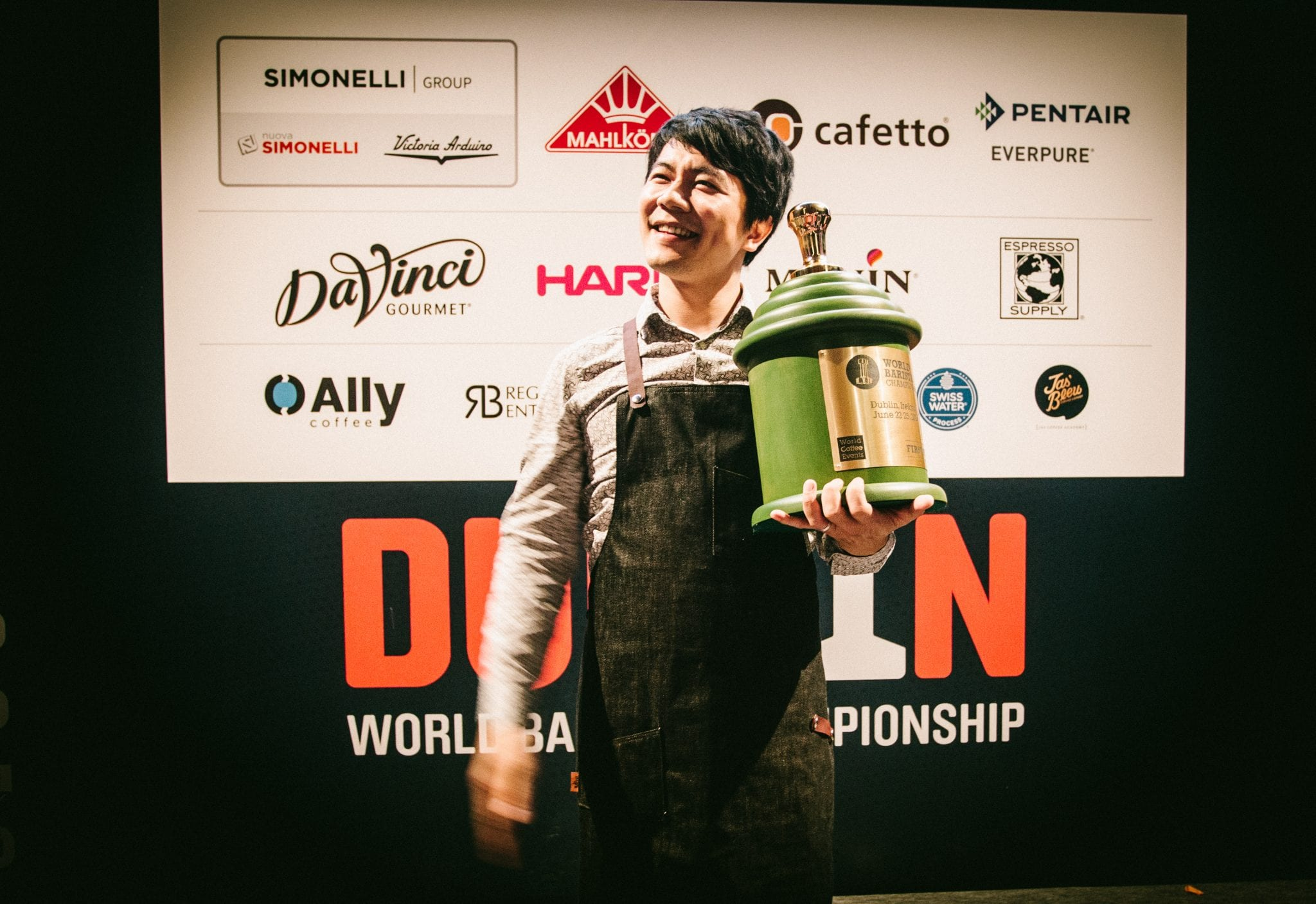 Berg Wu, 2016 World Barista Champion, with his trohpy