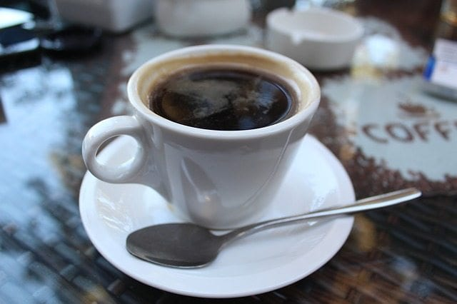 coffee cup, saucer, and spoon