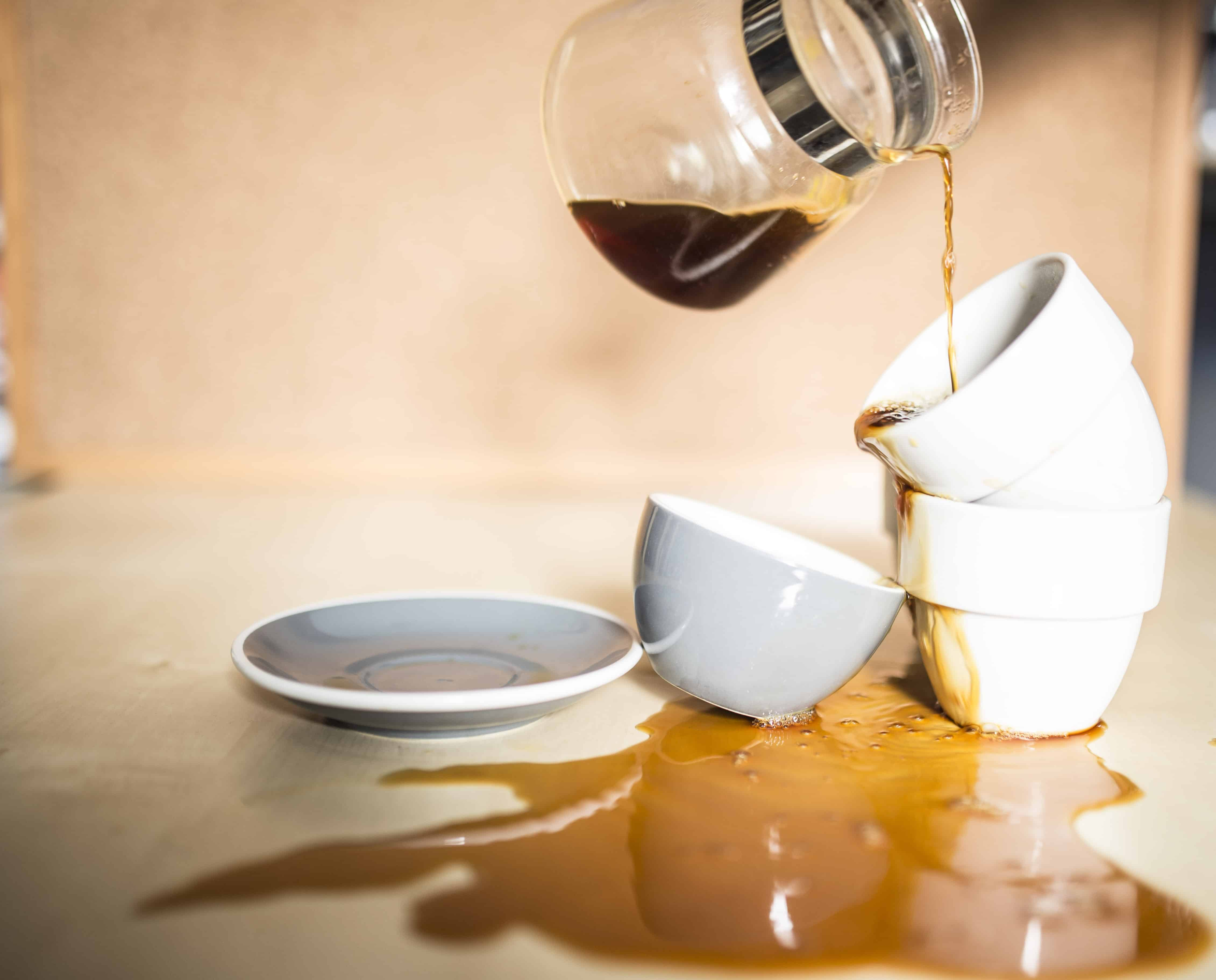 spilling coffee on table and cups