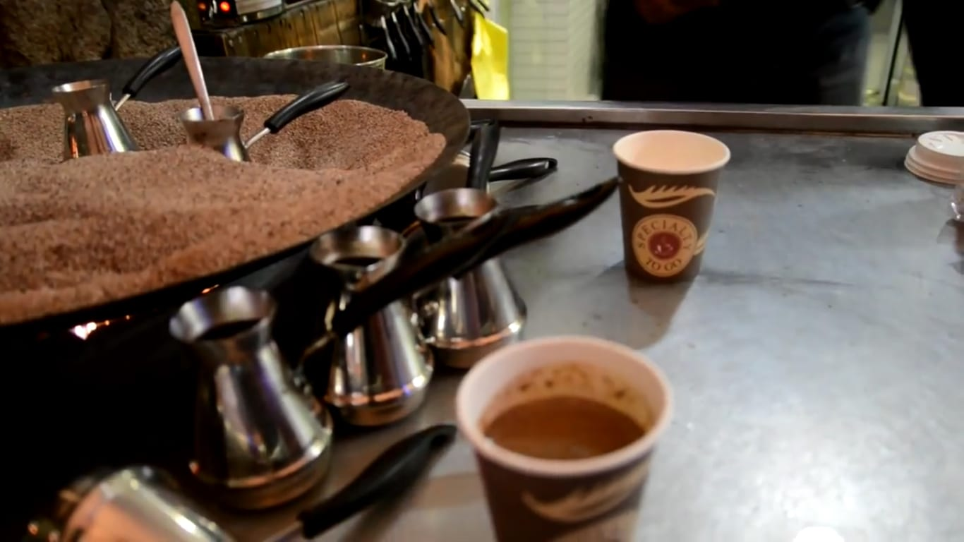 Turkish coffee being made with sand to conduct the heat