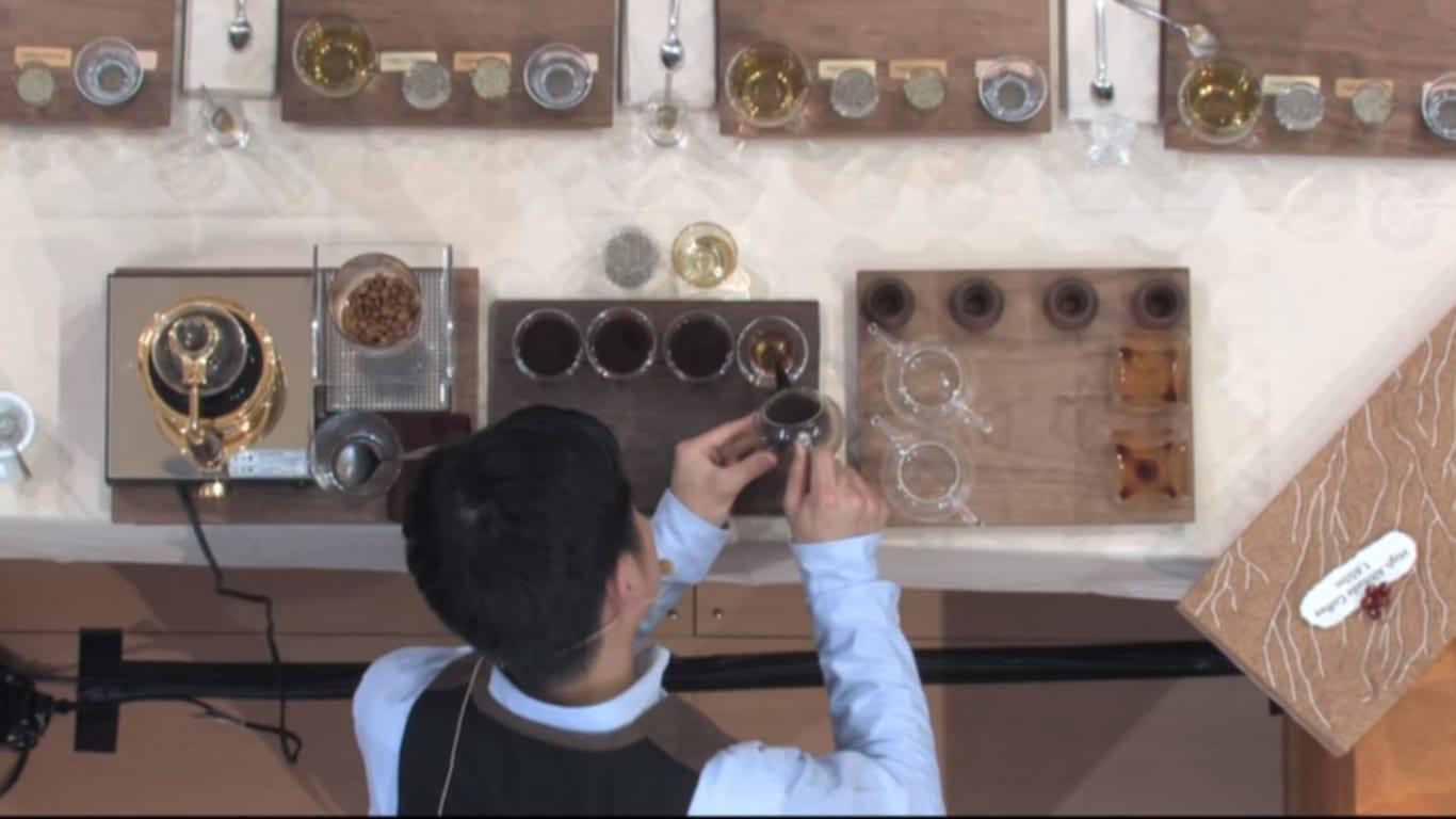 Hidenori Izaki preparing coffees while presenting on umami