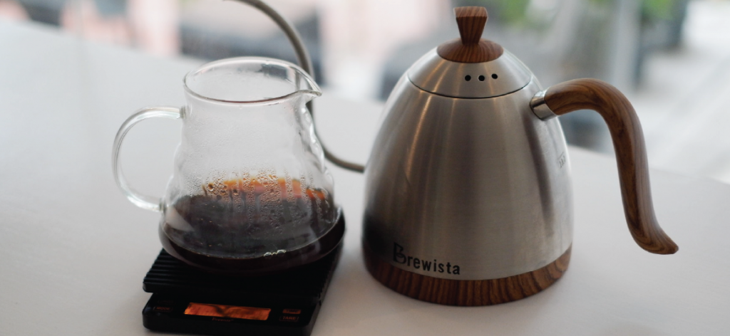 A kalita decanter with coffee and Brewista kettle