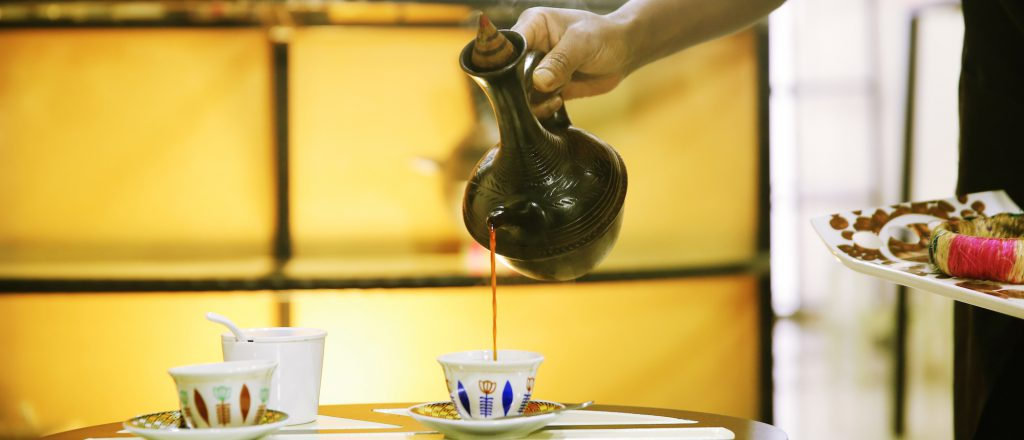 Barista serving turkey coffee in ceramic cups