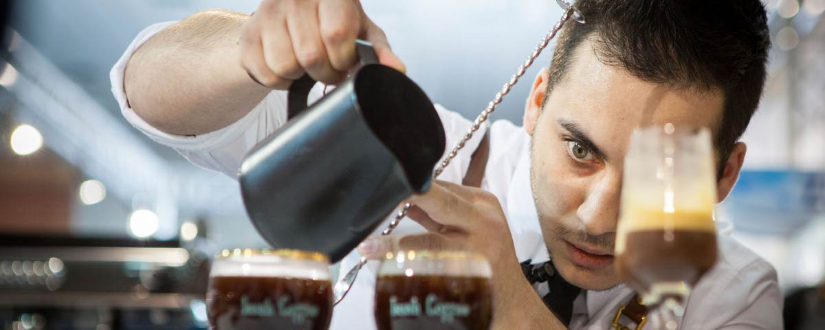 Barista macking a drink with coffee