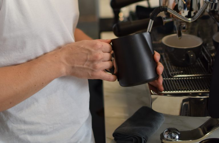 barista steaming milk