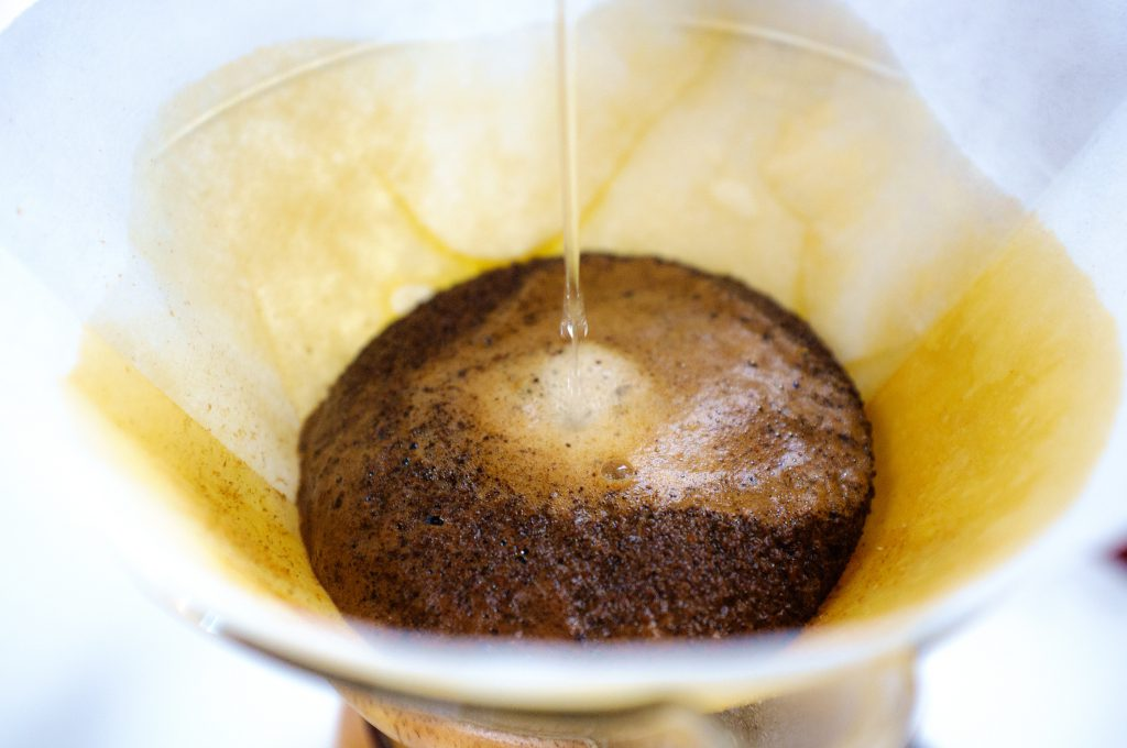 pouring water onto coffee grounds