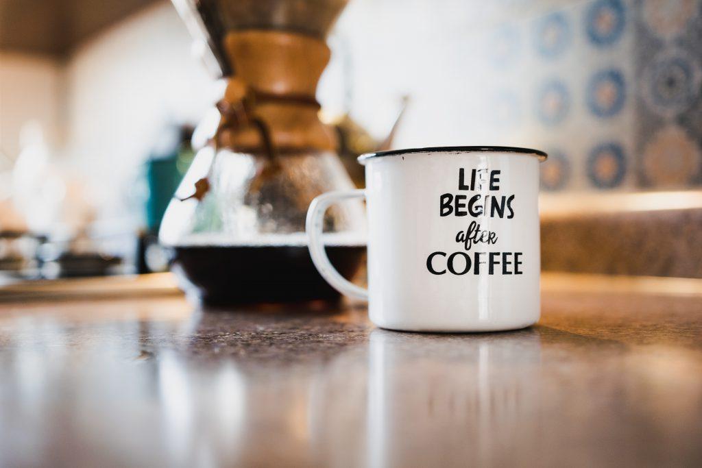 chemex and coffee mug on a table