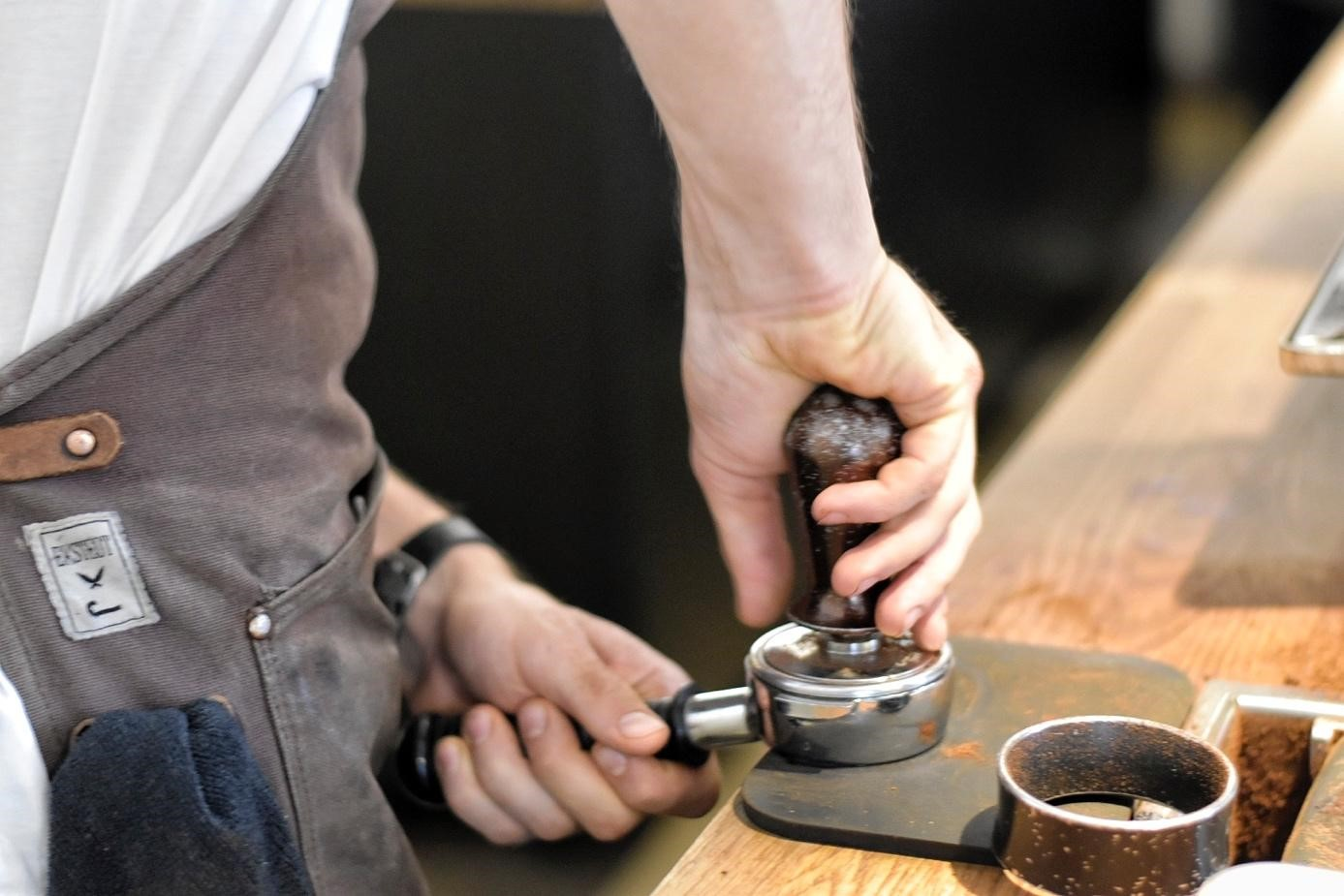 Barista tamping in the portafilter