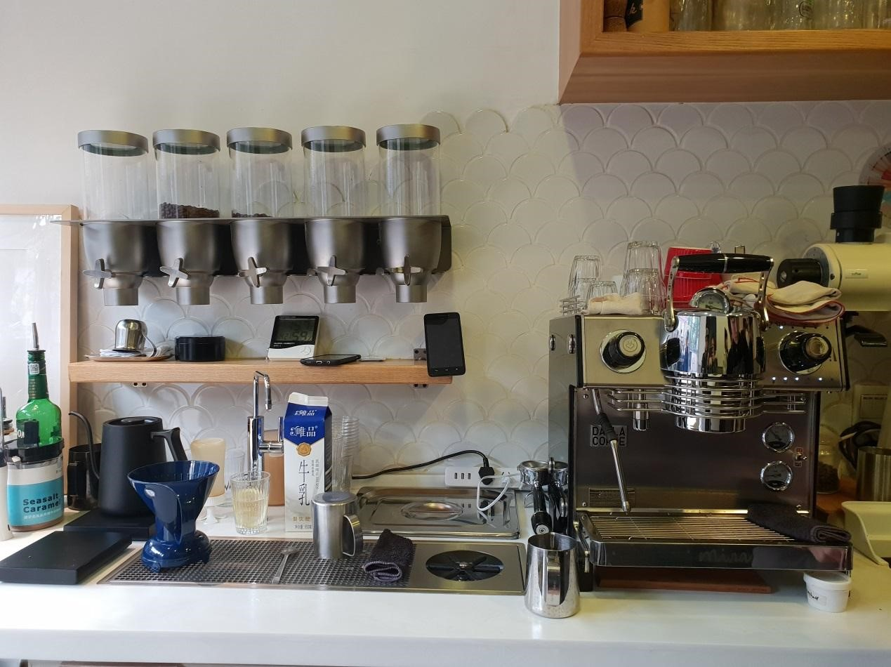 Bar of a local coffee shop in Shanghai with an espresso machine with one group