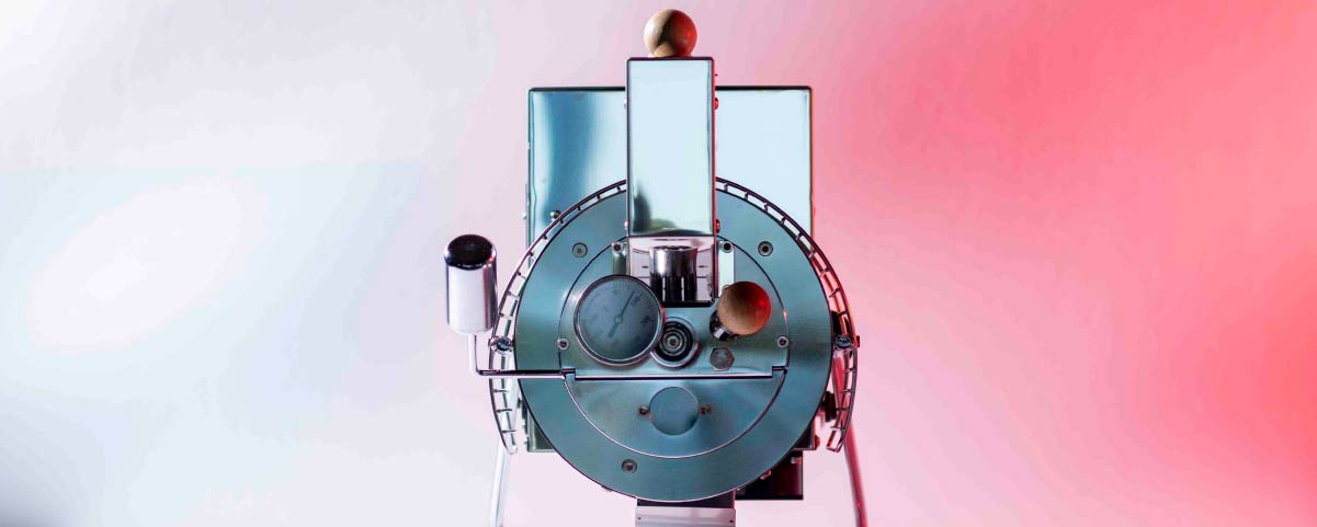 roaster machine with a pink background