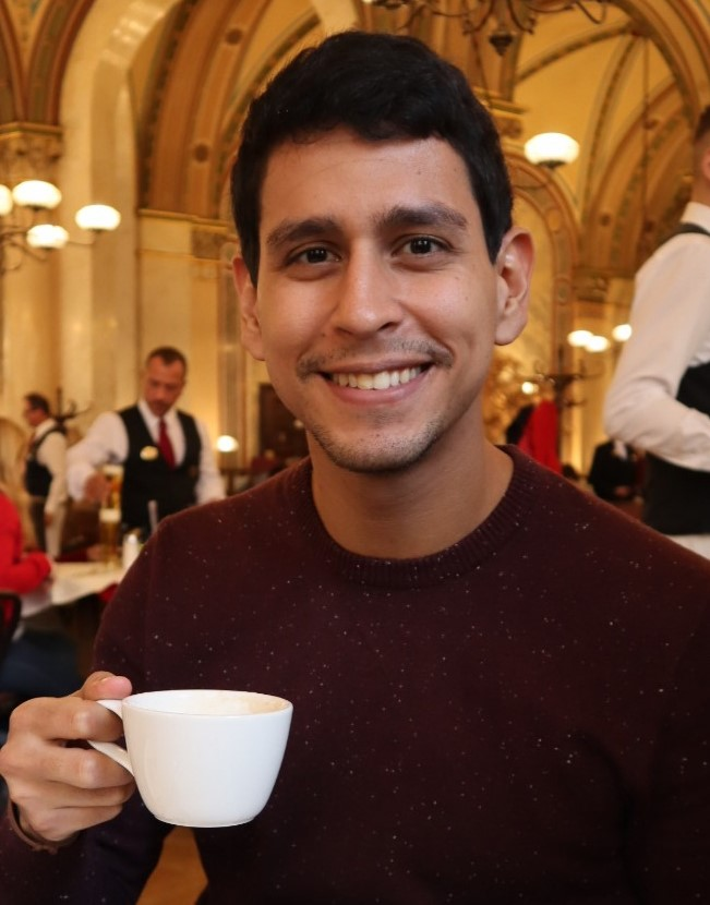 Man holding a white cup of coffee