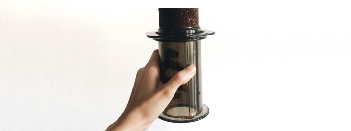 Woman holding an aeropress