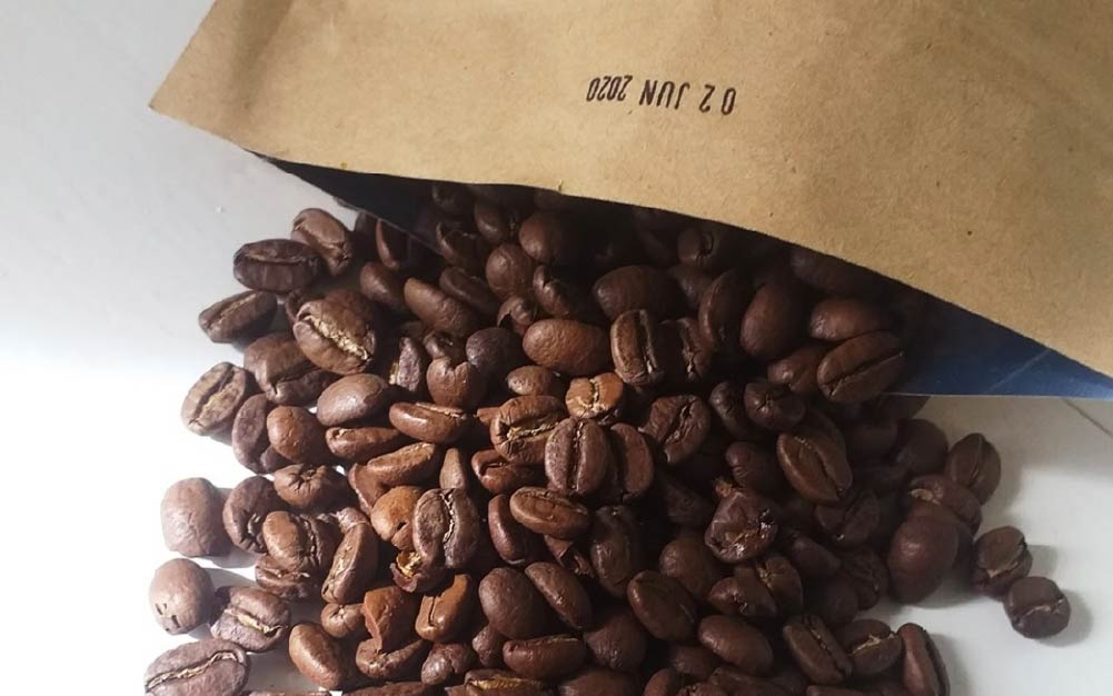 Roasted coffee beans falling from a bag, subscription