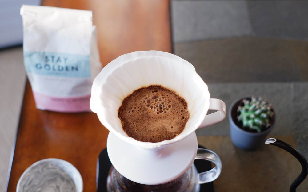 A cup of coffee on a table  Description automatically generated with medium confidence