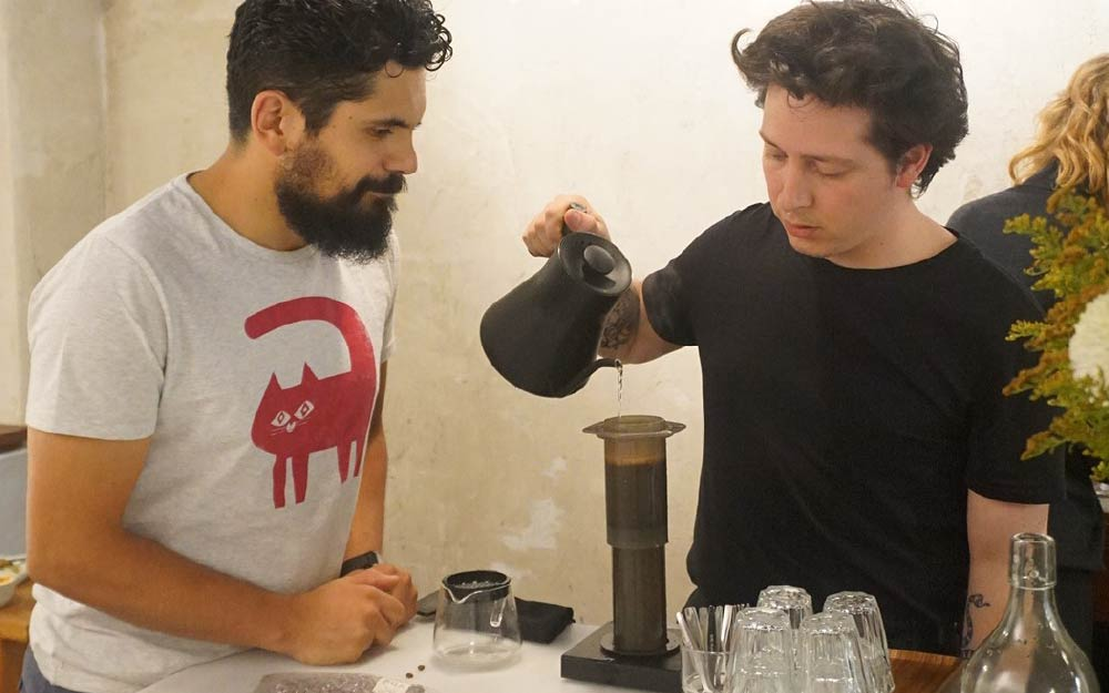 Barista brewing an inverted AeroPress