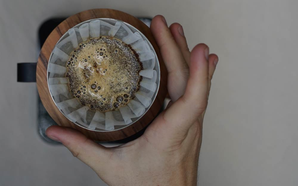 Baristas brewing three different V60, with dripper material