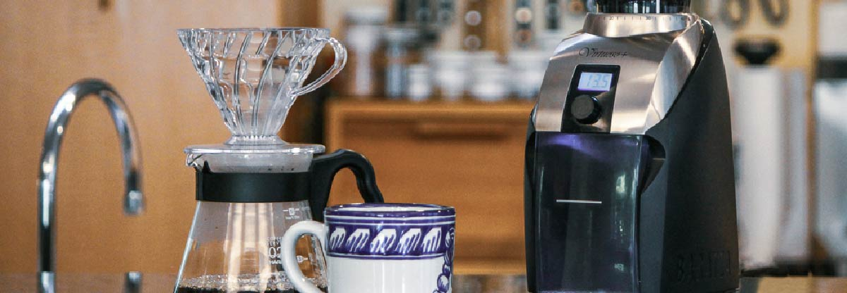 A V60 and a coffee grinder