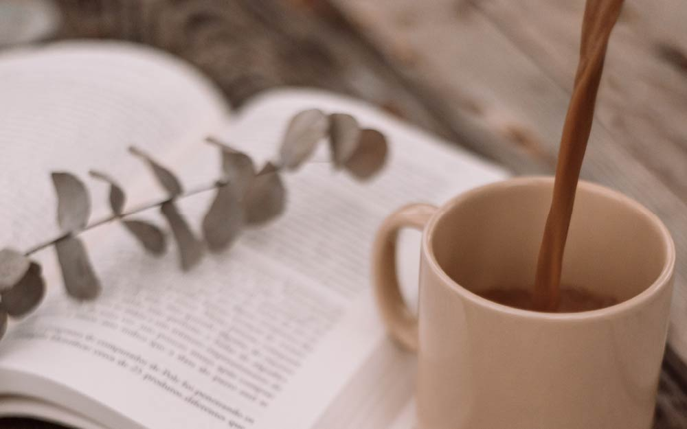 A book and a cup of coffee, supplement