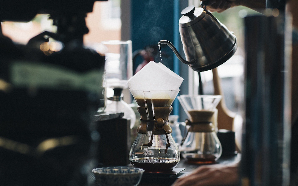 pouring water into chemex on table