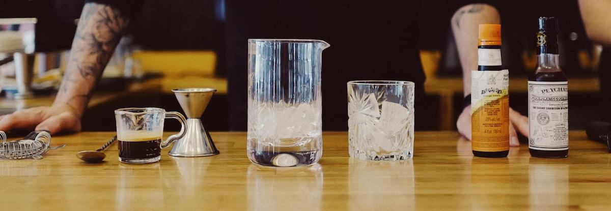 barista with espresso tonic ingredients