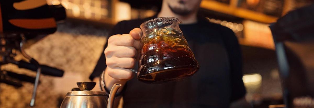 barista holding coffee jug