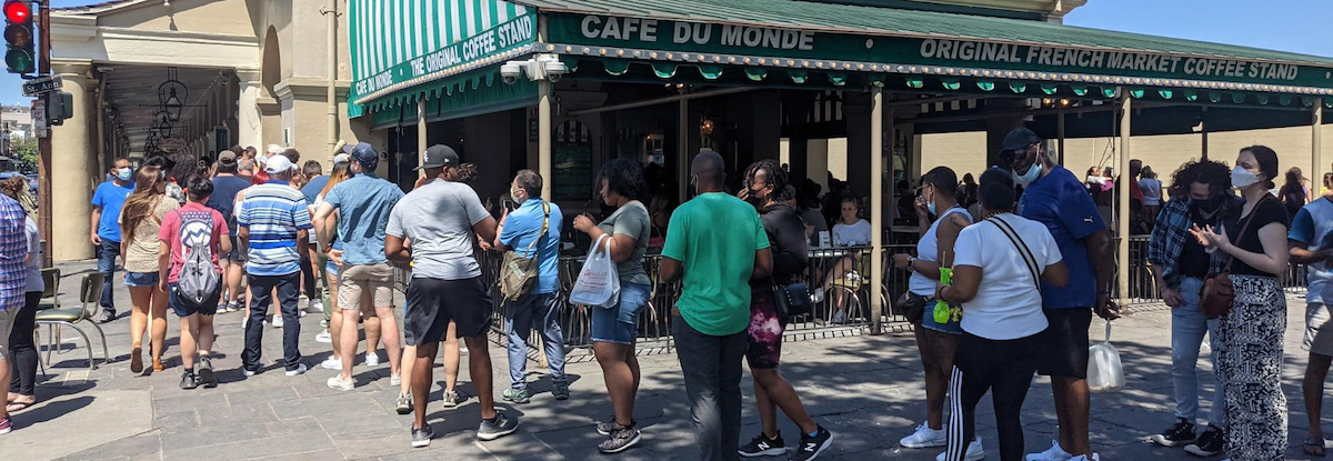 people waiting in line at a new orleans coffee shop