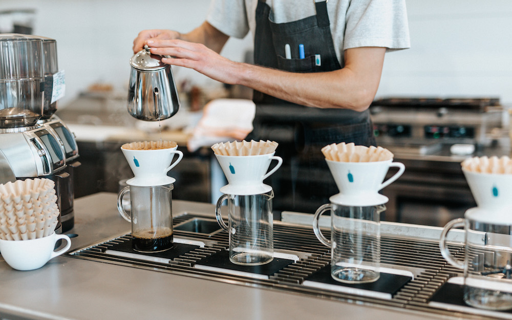 barista using pour overs